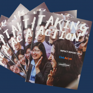 "CivicAction's 2018 Impact Report which is a booklet with the words ""Taking Action"" as the title overlayed on a photo of a crowd of people smiling and clapping."