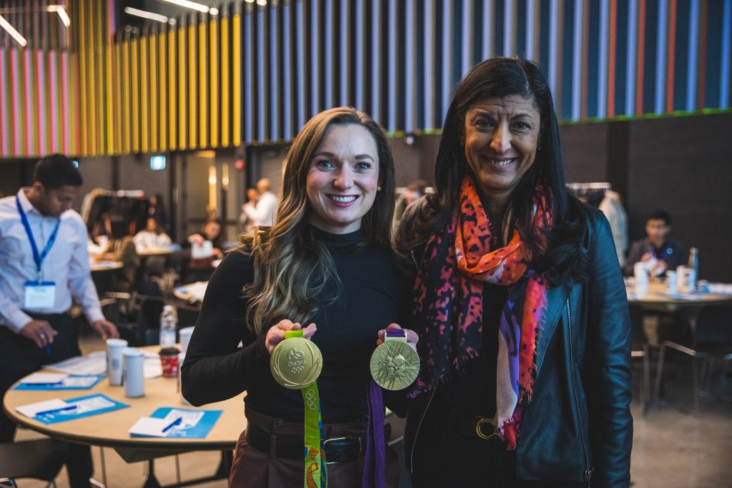 Rosie MacLennan and Zabeen Hirji post with Rosie's 2 Olympic gold medals.
