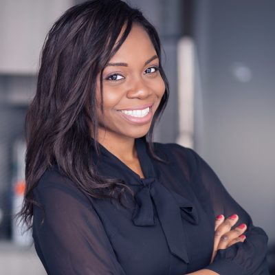 Chioma Ifeanyi-Okoro standing with her hands crossed.